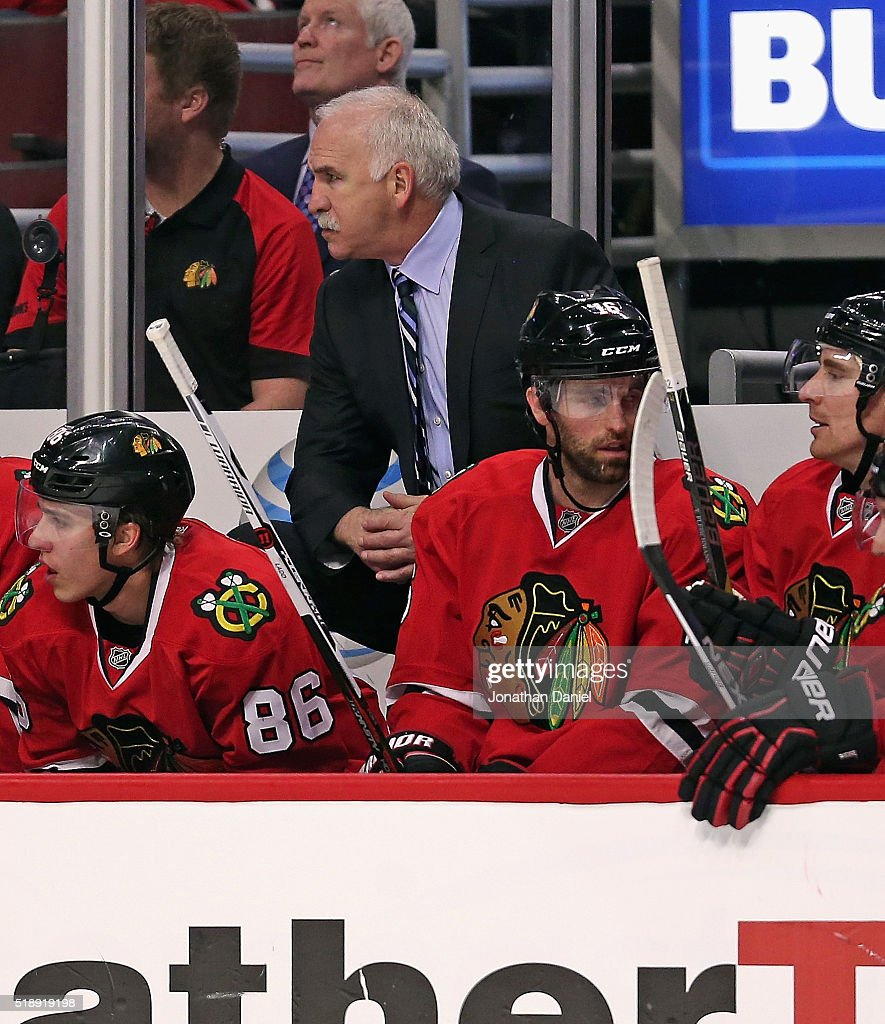 Head coach <a gi-track='captionPersonalityLinkClicked' href=/galleries/search?phrase=Joel+Quenneville&family=editorial&specificpeople=2094832 ng-click='$event.stopPropagation()'>Joel Quenneville</a> of the Chicago Blackhawks presides over his 800th career victory as a coach against the Boston Bruins at the United Center on April 3, 2016 in Chicago, Illinois. The Blackhawks defeated the Bruins 6-4.