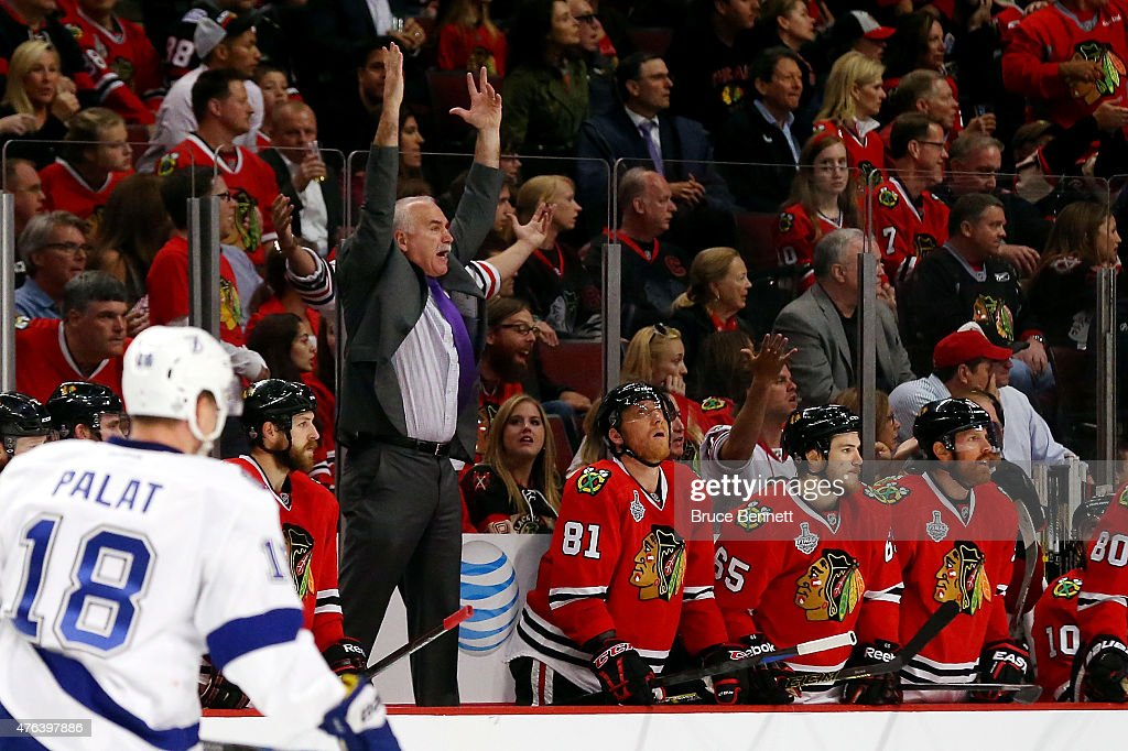 Head coach <a gi-track='captionPersonalityLinkClicked' href=/galleries/search?phrase=Joel+Quenneville&family=editorial&specificpeople=2094832 ng-click='$event.stopPropagation()'>Joel Quenneville</a> of the Chicago Blackhawks reacts from the bench against the Tampa Bay Lightning during Game Three of the 2015 NHL Stanley Cup Final at the United Center on June 8, 2015 in Chicago, Illinois.