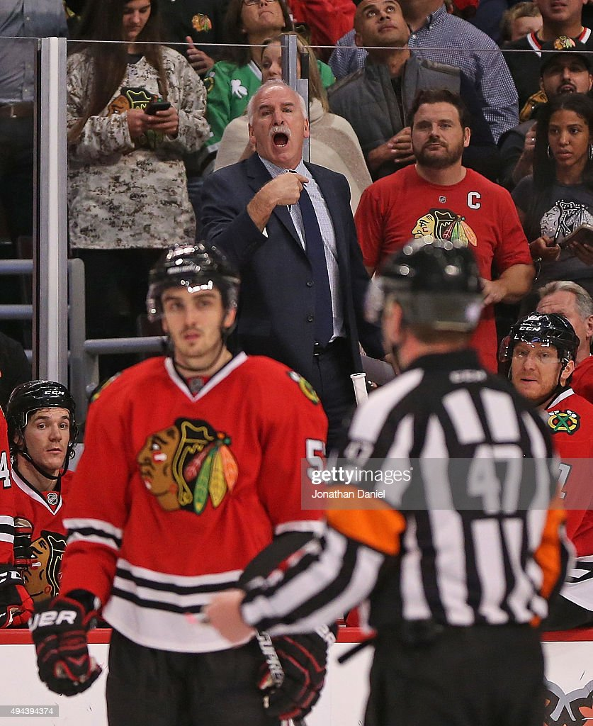 Head coach <a gi-track='captionPersonalityLinkClicked' href=/galleries/search?phrase=Joel+Quenneville&family=editorial&specificpeople=2094832 ng-click='$event.stopPropagation()'>Joel Quenneville</a> of the Chicago Blackhawks stands on the bench to yell at referee Trevor Hanson #47 during a game against the Anaheim Ducks at the United Center on October 26, 2015 in Chicago, Illinois. The Blackhawks defeated the Ducks 1-0 in overtime.