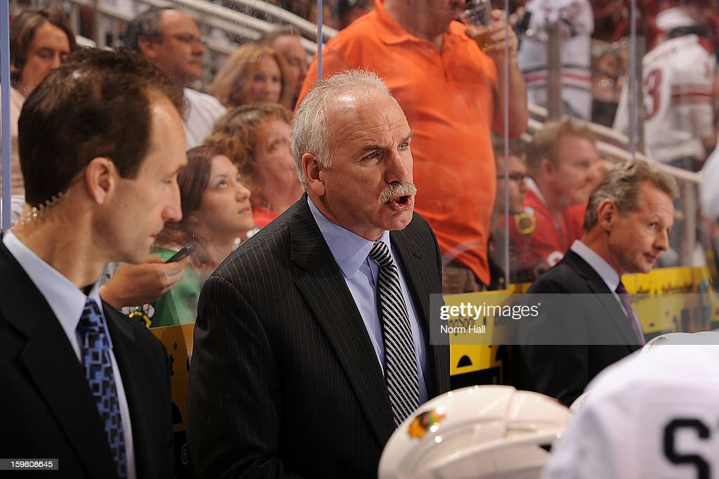 Head Coach Joel Quenneville of the Chicago Blackhawks talks to his team during a stop in play against the Phoenix Coyotes at Jobing.com Arena on January 20, 2013 in Glendale, Arizona.