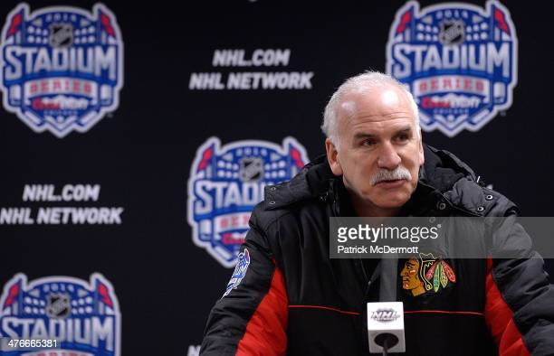 Head Coach Joel Quenneville of the Chicago Blackhawks talks with media during the 2014 NHL Stadium Series practice day on February 28 2014 at Soldier...