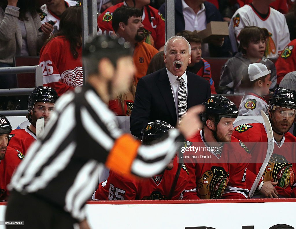 Head coach <a gi-track='captionPersonalityLinkClicked' href=/galleries/search?phrase=Joel+Quenneville&family=editorial&specificpeople=2094832 ng-click='$event.stopPropagation()'>Joel Quenneville</a> of the Chicago Blackhawks yells at a referee as his team takes on the Detroit Red Wings in Game Five of the Western Conference Semifinals during the 2013 NHL Stanley Cup Playoffs at the United Center on May 25, 2013 in Chicago, Illinois.