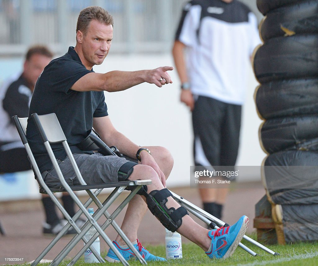 Head coach Joerg - Uwe Kluetz of Cloppenburg gives advice to his team during the Regionalliga North match between BV Cloppenburg and Goslarer SC at stadium Cloppenburg on August 2, 2013 in Cloppenburg, Germany.