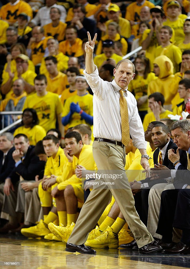 Head coach <a gi-track='captionPersonalityLinkClicked' href=/galleries/search?phrase=John+Beilein&family=editorial&specificpeople=233435 ng-click='$event.stopPropagation()'>John Beilein</a> calls a play from the bench while playing the Ohio State Buckeyes at Crisler Center on February 5, 2013 in Ann Arbor, Michigan. Michigan won the game 76-74 in overtime.
