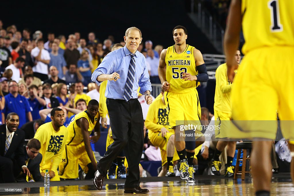 Head coach <a gi-track='captionPersonalityLinkClicked' href=/galleries/search?phrase=John+Beilein&family=editorial&specificpeople=233435 ng-click='$event.stopPropagation()'>John Beilein</a> of the Michigan Wolverines celebrates late in their 87 to 85 win over the Kansas Jayhawks in overtime during the South Regional Semifinal round of the 2013 NCAA Men's Basketball Tournament at Dallas Cowboys Stadium on March 29, 2013 in Arlington, Texas.