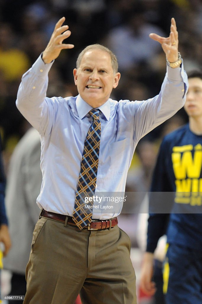 Head coach <a gi-track='captionPersonalityLinkClicked' href=/galleries/search?phrase=John+Beilein&family=editorial&specificpeople=233435 ng-click='$event.stopPropagation()'>John Beilein</a> of the Michigan Wolverines reacts to a call during the Progressive Legends Classic college basketball game against the Oregon Ducks at the Barclays Center on November 24, 2014 in the Brooklyn borough of New York City. The Wildcats won 70-63.