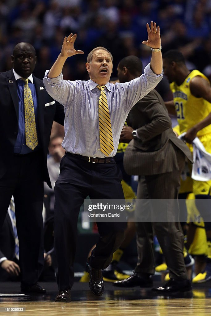 Head coach <a gi-track='captionPersonalityLinkClicked' href=/galleries/search?phrase=John+Beilein&family=editorial&specificpeople=233435 ng-click='$event.stopPropagation()'>John Beilein</a> of the Michigan Wolverines shouts late in the second half against the Kentucky Wildcats during the midwest regional final of the 2014 NCAA Men's Basketball Tournament at Lucas Oil Stadium on March 30, 2014 in Indianapolis, Indiana.