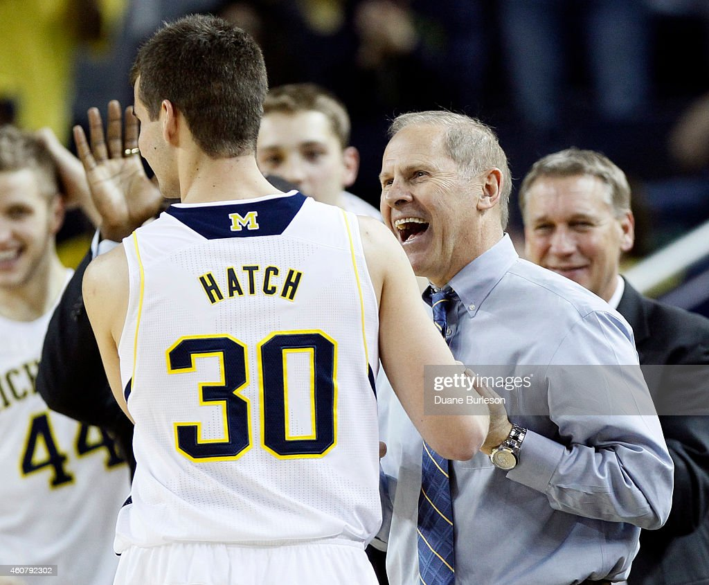 Head coach <a gi-track='captionPersonalityLinkClicked' href=/galleries/search?phrase=John+Beilein&family=editorial&specificpeople=233435 ng-click='$event.stopPropagation()'>John Beilein</a> of the Michigan Wolverines smiles at Austin Hatch #30 as he leaves the game against the Coppin State University Eagles after scoring his first-career regular season point during the second half at Crisler Arena on December 22, 2014 in Ann Arbor, Michigan. Michigan defeated Coppin State 72-56.