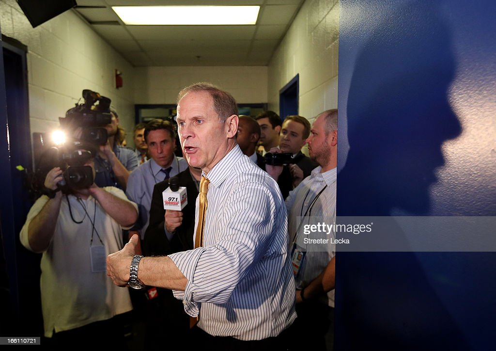 Head coach John Beilein of the Michigan Wolverines speaks in the locker room after they lost 82-76 against the Louisville Cardinals during the 2013 NCAA Men's Final Four Championship at the Georgia Dome on April 8, 2013 in Atlanta, Georgia.