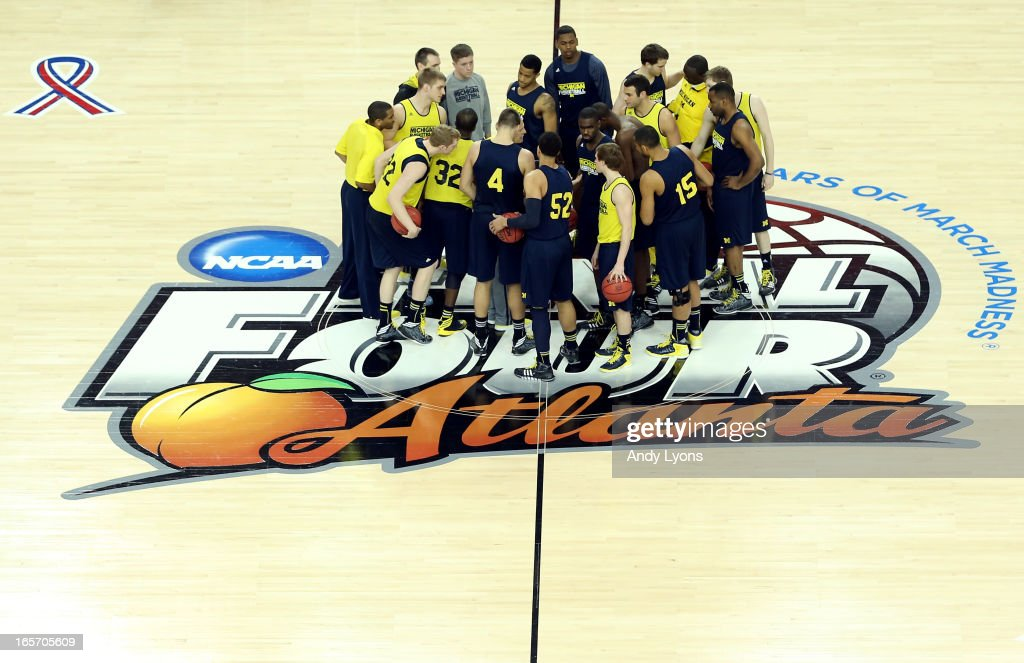 Head coach <a gi-track='captionPersonalityLinkClicked' href=/galleries/search?phrase=John+Beilein&family=editorial&specificpeople=233435 ng-click='$event.stopPropagation()'>John Beilein</a> of the Michigan Wolverines talks to the team at center court during practice prior to the NCAA Men's Final Four at the Georgia Dome on April 5, 2013 in Atlanta, Georgia.