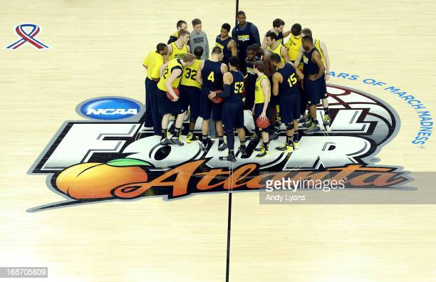 Head coach John Beilein of the Michigan Wolverines talks to the team at center court during practice prior to the NCAA Men's Final Four at the...