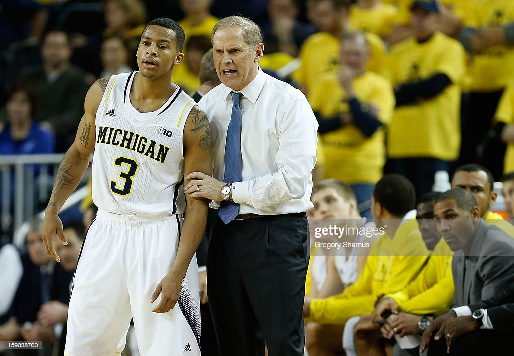 Head coach <a gi-track='captionPersonalityLinkClicked' href=/galleries/search?phrase=John+Beilein&family=editorial&specificpeople=233435 ng-click='$event.stopPropagation()'>John Beilein</a> of the Michigan Wolverines talks with Trey Burke #3 during the first half while playing the Iowa Hawkeyes at Crisler Center on January 6, 2013 in Ann Arbor, Michigan. Michigan won the game 95-67.
