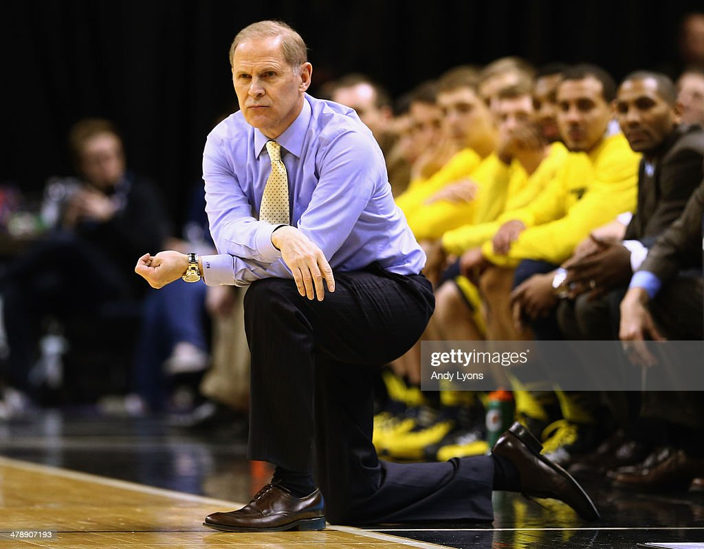 Head coach John Beilein of the Michigan Wolverines watches his team during the first half of the Big Ten Basketball Tournament Semifinal game against the Ohio State Buckeyes at Bankers Life Fieldhouse on March 15, 2014 in Indianapolis, Indiana.
