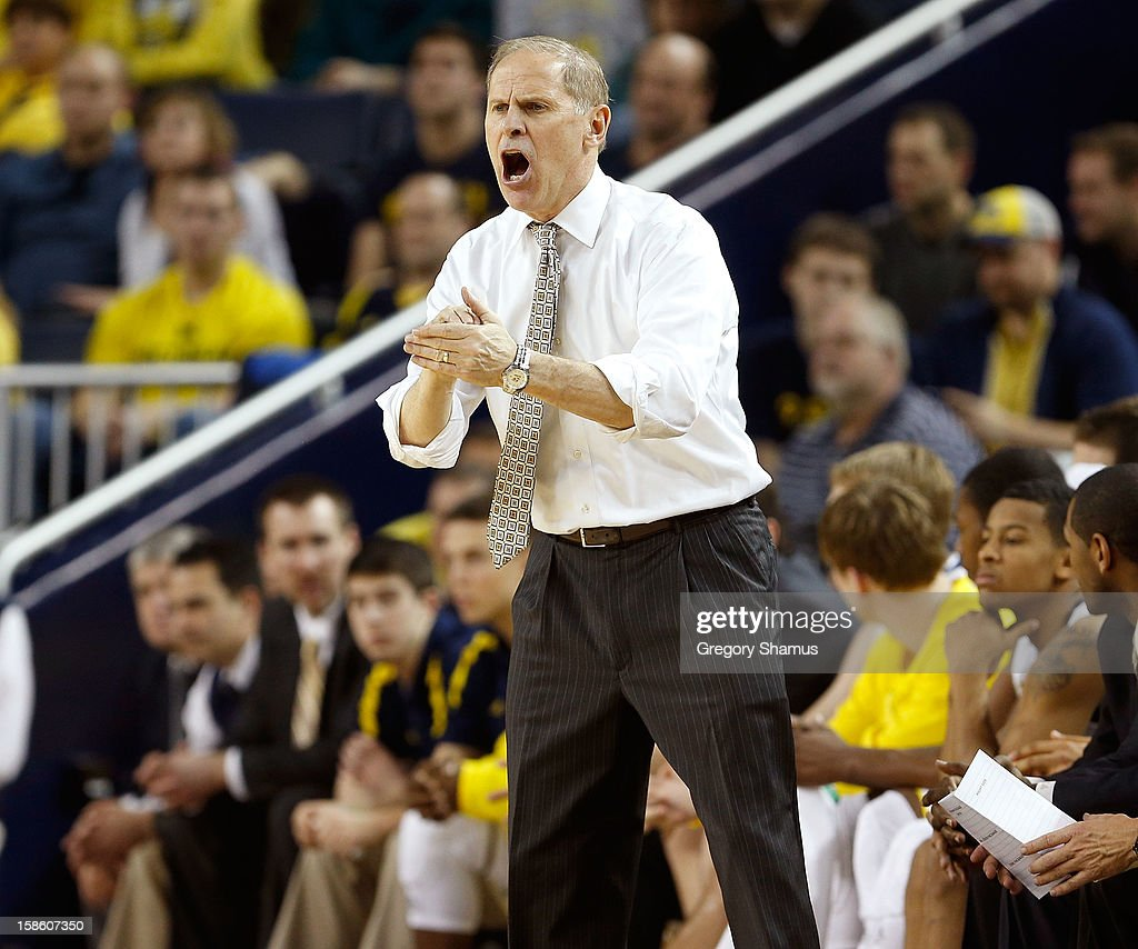 Head coach <a gi-track='captionPersonalityLinkClicked' href=/galleries/search?phrase=John+Beilein&family=editorial&specificpeople=233435 ng-click='$event.stopPropagation()'>John Beilein</a> reacts from the bench during the second half while playing the Eastern Michigan Eagles at Crisler Center on December 20, 2012 in Ann Arbor, Michigan.