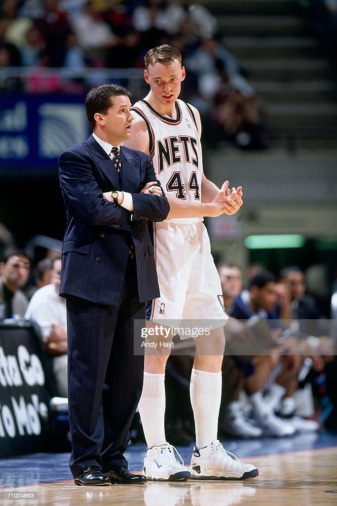 Head coach John Calipari and Keith Van Horn of the New Jersey Nets chat on the sideline during a game against the New York Knicks at Continental...