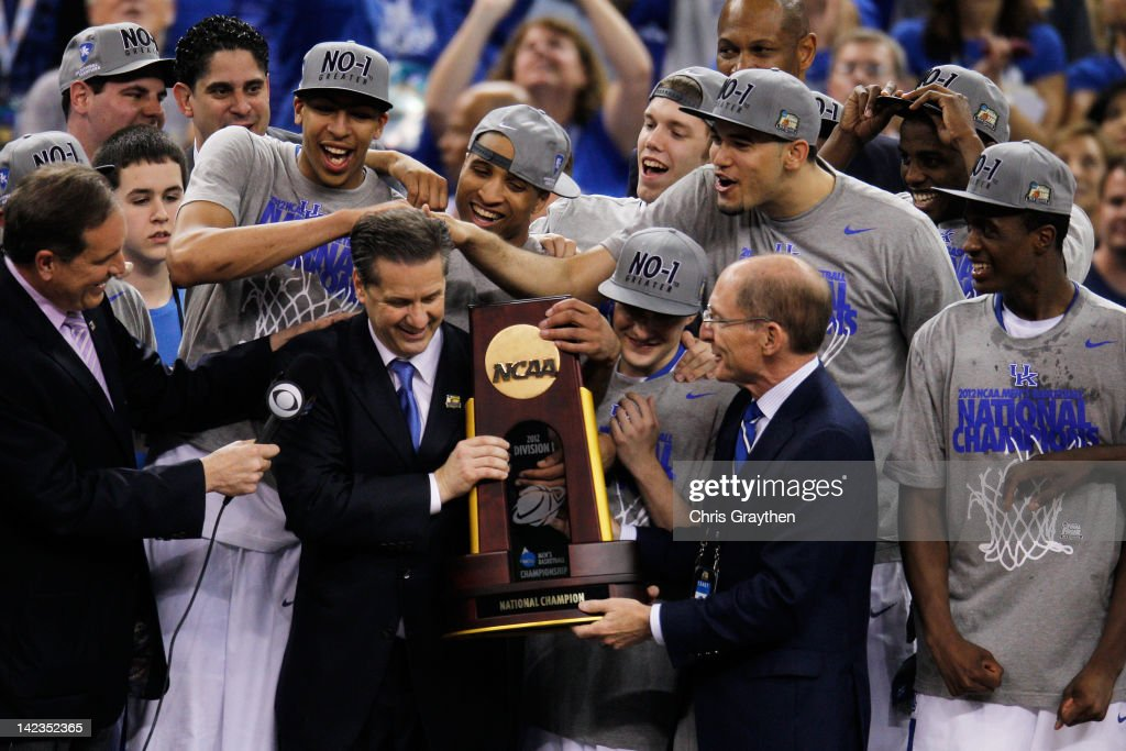 Head coach John Calipari and Kentucky President Eli Capilouto hold the trophy after the Wildcats defeat the Kansas Jayhawks 6759 in the National...