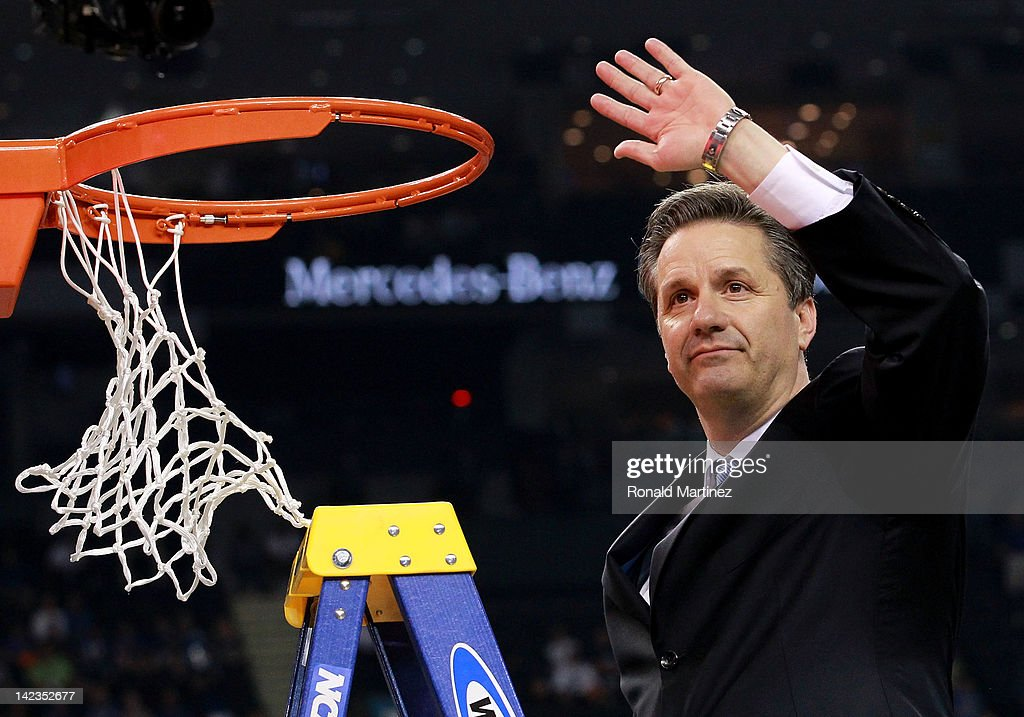 Head coach John Calipari celebrates as he cuts down the net after the Wildcats defeat the Kansas Jayhawks 6759 in the National Championship Game of...