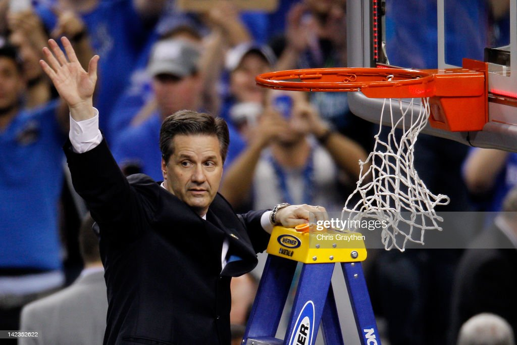 Head coach John Calipari celebrates as he prepares to cut down the net after the Wildcats defeat the Kansas Jayhawks 67-59 in the National Championship Game of the 2012 NCAA Division I Men's Basketball Tournament at the Mercedes-Benz Superdome on April 2, 2012 in New Orleans, Louisiana.