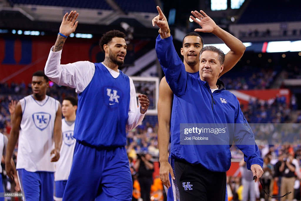 Head coach John Calipari of the Kentucky Wildcats acknowledges the fans with Willie Cauley-Stein #15 and Dakari Johnson #44 during practice for the NCAA Men's Final Four at Lucas Oil Stadium on April 3, 2015 in Indianapolis, Indiana.