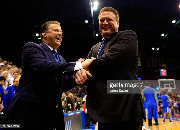 Head coach John Calipari of the Kentucky Wildcats and head coach Bill Self of the Kansas Jayhawks greet each other prior to the game at Allen...