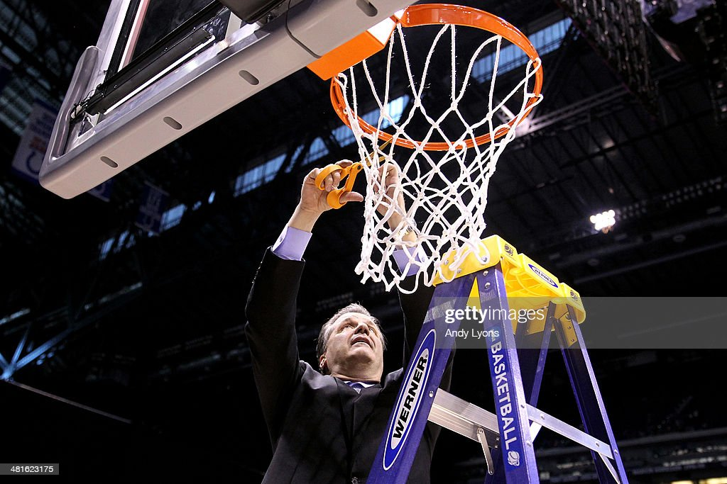 Head coach <a gi-track='captionPersonalityLinkClicked' href=/galleries/search?phrase=John+Calipari&family=editorial&specificpeople=619983 ng-click='$event.stopPropagation()'>John Calipari</a> of the Kentucky Wildcats cuts the net after defeating the Michigan Wolverines 75 to 72 in the midwest regional final of the 2014 NCAA Men's Basketball Tournament at Lucas Oil Stadium on March 30, 2014 in Indianapolis, Indiana.