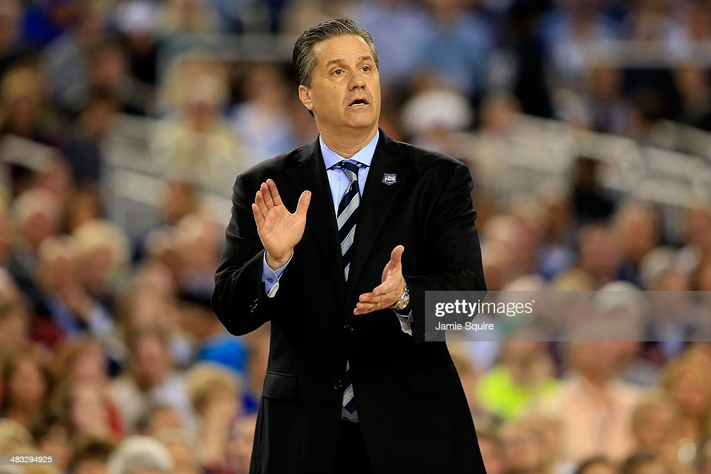 Head coach John Calipari of the Kentucky Wildcats motions to his players during the NCAA Men's Final Four Championship against the Connecticut Huskies at AT&T Stadium on April 7, 2014 in Arlington, Texas.
