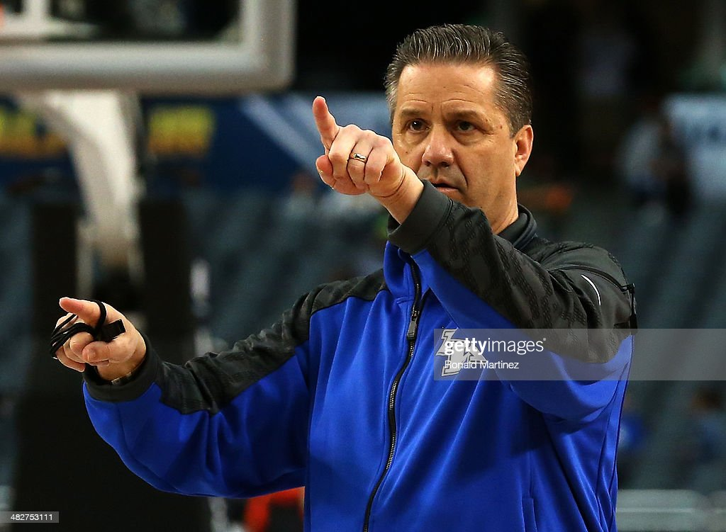 Head coach <a gi-track='captionPersonalityLinkClicked' href=/galleries/search?phrase=John+Calipari&family=editorial&specificpeople=619983 ng-click='$event.stopPropagation()'>John Calipari</a> of the Kentucky Wildcats points while the Wildcats practice ahead of the 2014 NCAA Men's Final Four at AT&T Stadium on April 4, 2014 in Arlington, Texas.