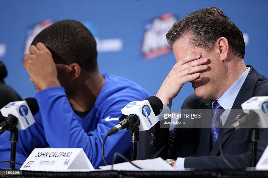 Head coach John Calipari of the Kentucky Wildcats reacts in the post game press conference after being defeated by the Wisconsin Badgers during the NCAA Men's Final Four Semifinal at Lucas Oil Stadium on April 4, 2015 in Indianapolis, Indiana. Wisconsin defeated Kentucky 71-64.