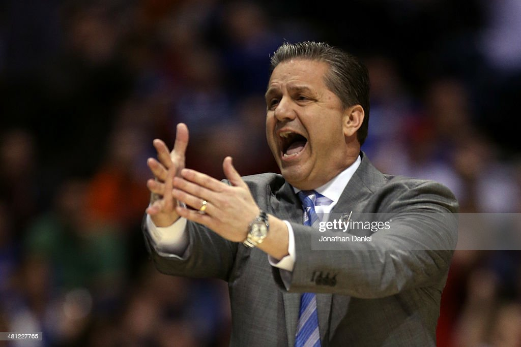Head coach John Calipari of the Kentucky Wildcats shouts to his team against the Louisville Cardinals during the regional semifinal of the 2014 NCAA Men's Basketball Tournament at Lucas Oil Stadium on March 28, 2014 in Indianapolis, Indiana.