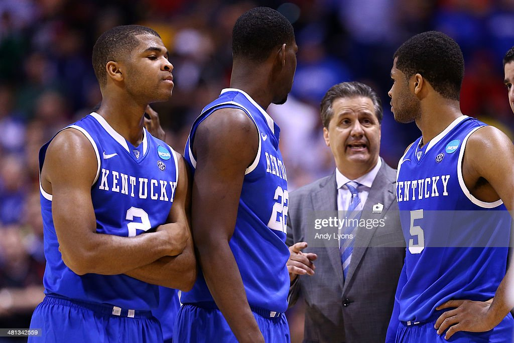 Head coach <a gi-track='captionPersonalityLinkClicked' href=/galleries/search?phrase=John+Calipari&family=editorial&specificpeople=619983 ng-click='$event.stopPropagation()'>John Calipari</a> of the Kentucky Wildcats talks with Aaron Harrison #2, Alex Poythress #22 and Andrew Harrison #5 against the Louisville Cardinals during the regional semifinal of the 2014 NCAA Men's Basketball Tournament at Lucas Oil Stadium on March 28, 2014 in Indianapolis, Indiana.