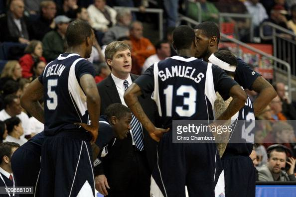 Head coach John Dunne of the St Peter's Peacocks talks with his players during a timeout against the Iona Gaels during the final of the MAAC men's...