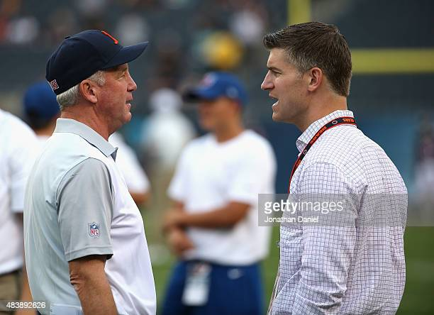 Head coach John Fox and general manager Ryan Pace of the Chicago Bears chat before warmups before a preseason game against the Miami Dolphins game at...