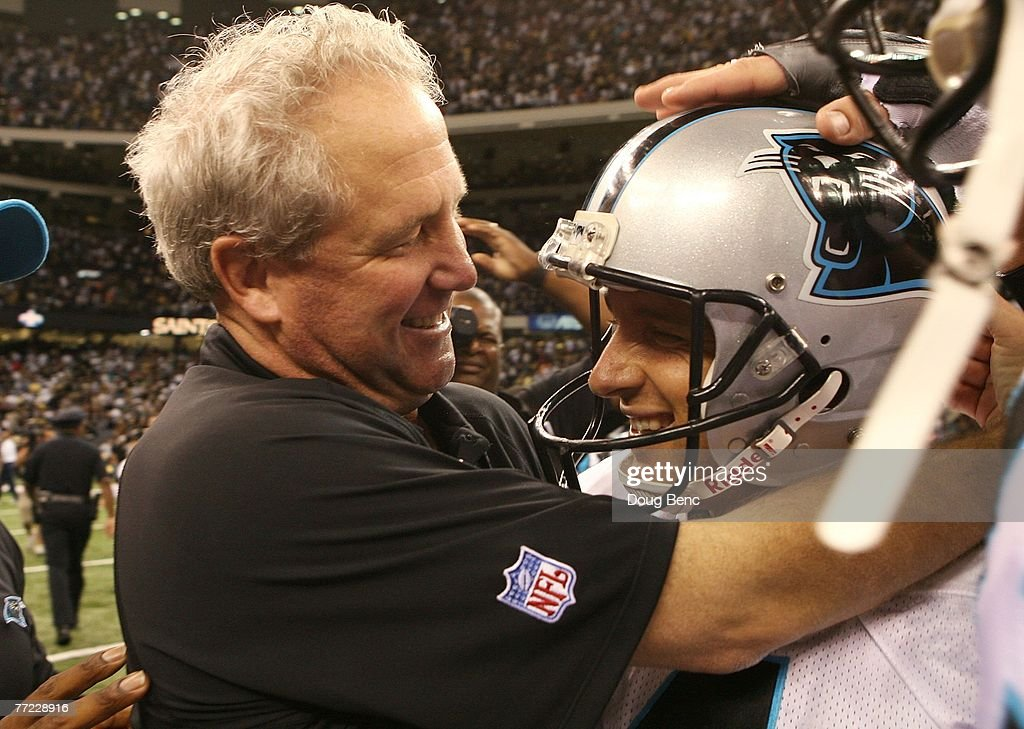 Head coach John Fox of the Carolina Panthers congratulates place kicker John Kasay #4 after Kasay kicked the game-winning field goal as time expired against the New Orleans Saints at the Superdome on October 7, 2007 in New Orleans, Louisiana. The Panthers defeated the Saints 16-13.