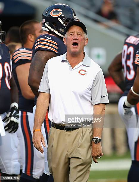 Head coach John Fox of the Chicago Bears gives instructions to his team during warmups before a preseason game against the Miami Dolphins at Soldier...