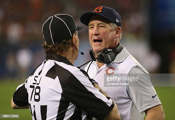 Head coach John Fox of the Chicago Bears jaws with side judge Greg Meyer during a preseason game against the Cleveland Browns at Soldier Field on...