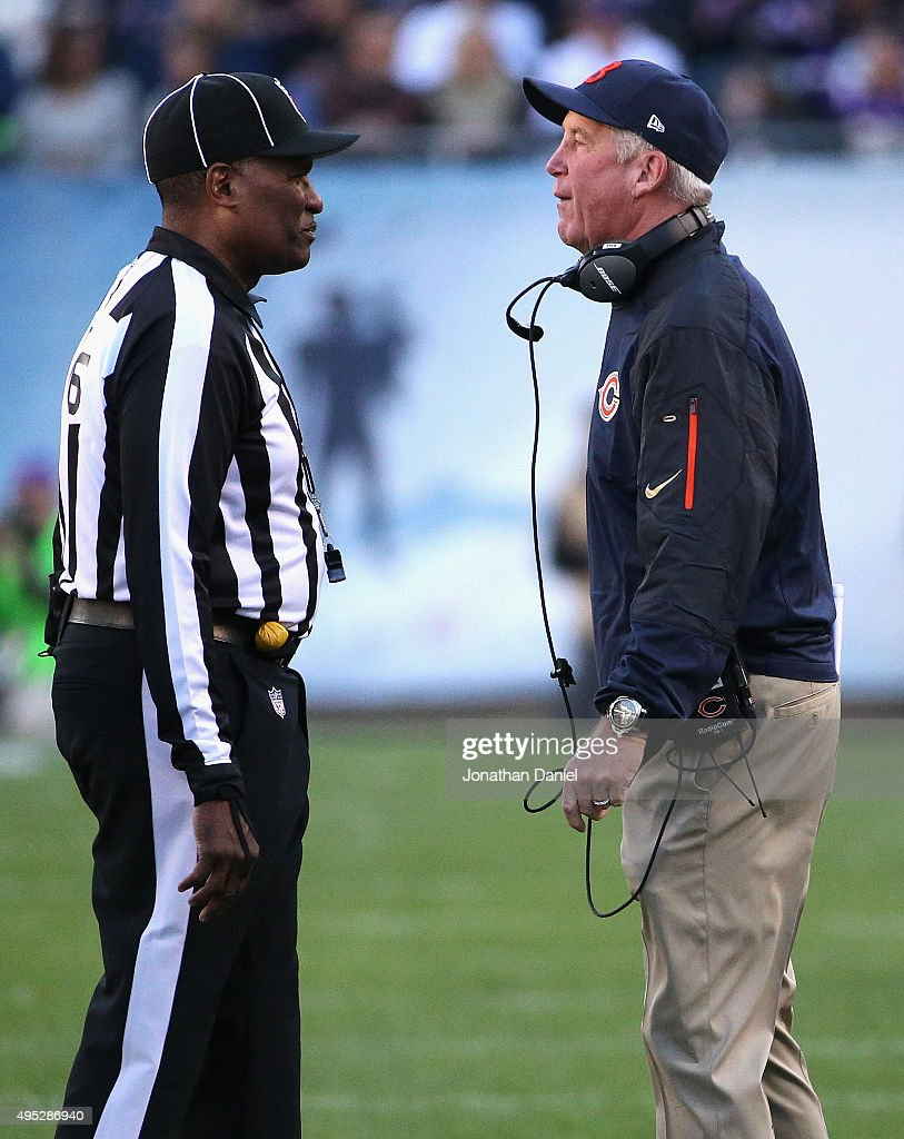 Head coach John Fox of the Chicago Bears talks with head linesman Wayne Mackie during a game against the Minnesota Vikings at Soldier Field on...