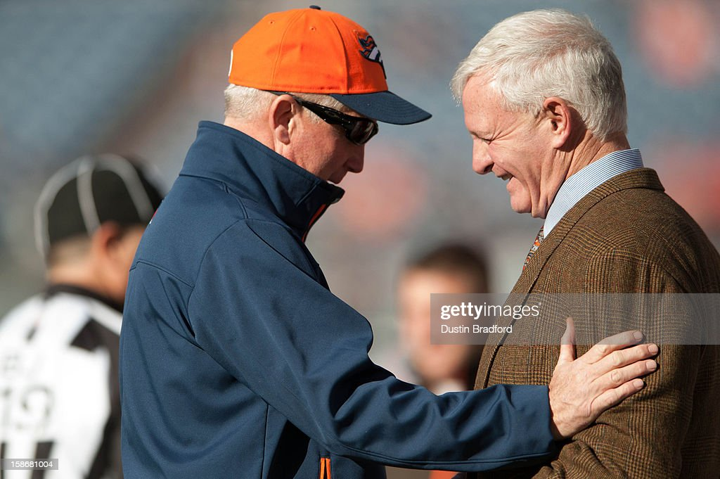 Head coach John Fox of the Denver Broncos has a word with Browns owner Jimmy Haslam III prior to a game at Sports Authority Field at Mile High on December 23, 2012 in Denver, Colorado.