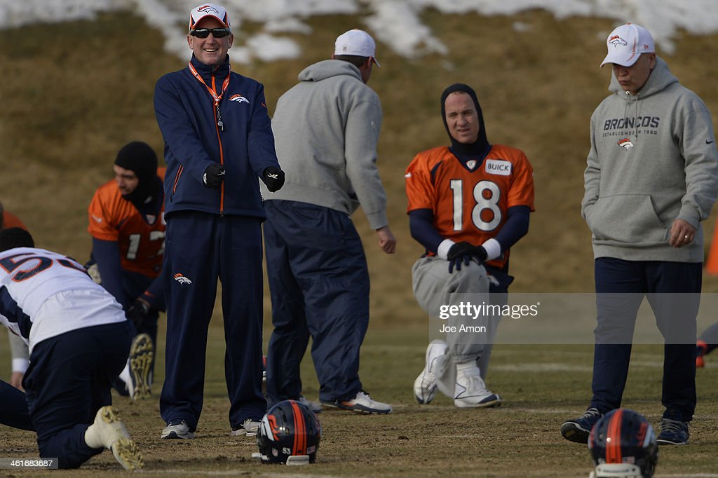 Head coach John Fox of the Denver Broncos joking with the team during warm ups at practice in Centennial January 10, 2014 Centennial, Colorado.