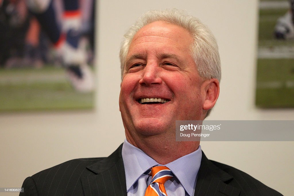 Head coach <a gi-track='captionPersonalityLinkClicked' href=/galleries/search?phrase=John+Fox+-+Coach&family=editorial&specificpeople=206657 ng-click='$event.stopPropagation()'>John Fox</a> of the Denver Broncos smiles as quarterback Peyton Manning speaks during a news conference announcing Manning's contract with the Denver Broncos in the team meeting room at the Paul D. Bowlen Memorial Broncos Centre on March 20, 2012 in Englewood, Colorado. Manning, entering his 15th NFL season, was released by the Indianapolis Colts on March 7, 2012, where he had played his whole career. It has been reported that Manning will sign a five-year, $96 million offer.
