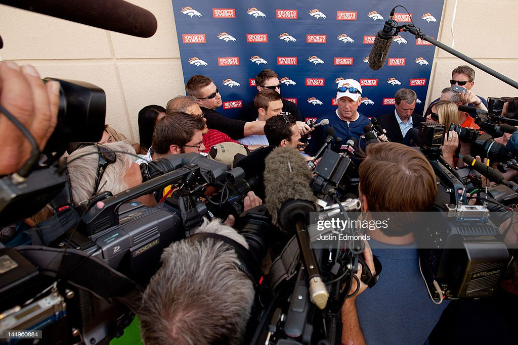 Head coach John Fox of the Denver Broncos talks to the local and national media following organized team activities at Dove Valley on May 21, 2012 in Englewood, Colorado.