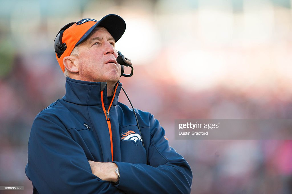 Head coach John Fox of the Denver Broncos watches a replay from the sideline during a game against the Cleveland Browns at Sports Authority Field Field at Mile High on December 23, 2012 in Denver, Colorado.
