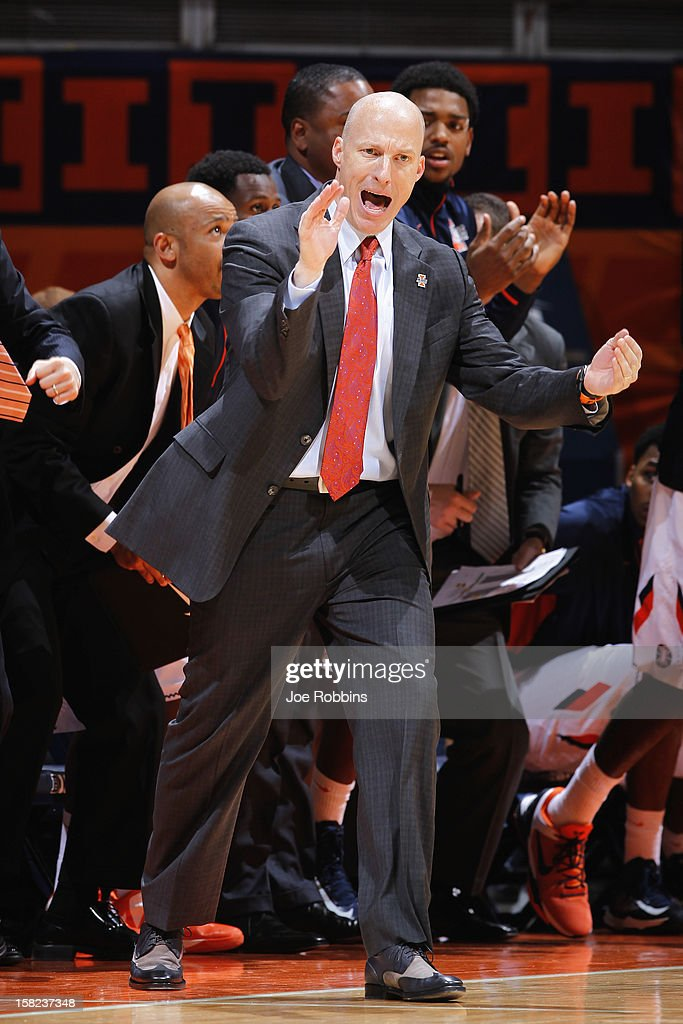 Head coach John Groce of the Illinois Fighting Illini encourages his team against the Norfolk State Spartans during the game at Assembly Hall on December 11, 2012 in Champaign, Illinois. Illinois won 64-54.
