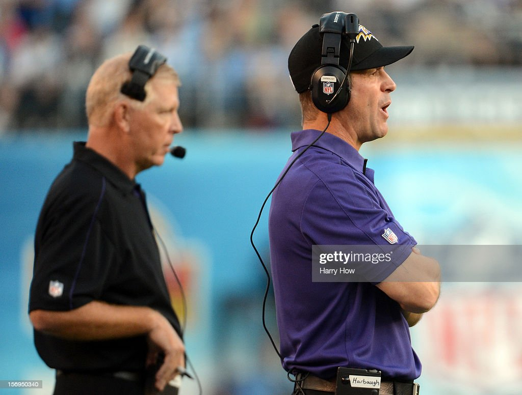 Head Coach John Harbaugh and Offensive Coordinator Cam Cameron of the Baltimore Ravens watch from the sidelines during a 16-13 win over the San Diego Chargers at Qualcomm Stadium on November 25, 2012 in San Diego, California.