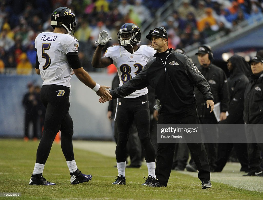 Head coach John Harbaugh of the Baltimore Raven congratulates Joe Flacco #5 after a Ravens touchdown against the Chicago Bears during the first quarter Ravensson November 17, 2013 at Soldier Field in Chicago, Illinois.