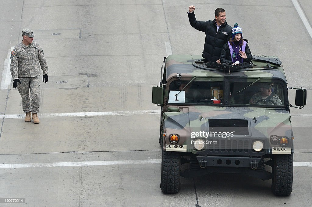 Head coach John Harbaugh of the Baltimore Ravens and his daughter, Alison, wave to fans as he and his players celebrate during their Super Bowl XLVII victory parade near M&T Bank Stadium on February 5, 2013 in Baltimore, Maryland. The Baltimore Ravens captured their second Super Bowl title by defeating the San Francisco 49ers.