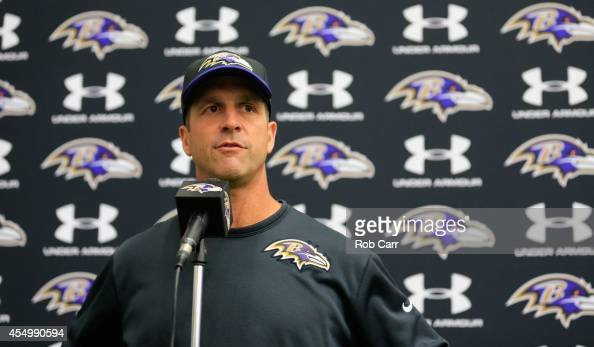Head coach John Harbaugh of the Baltimore Ravens answers questions during a news conference at the teams training facility on September 8 2014 in...