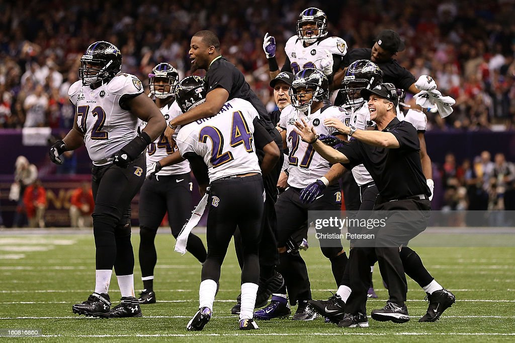 Head coach John Harbaugh of the Baltimore Ravens celebrates a play with his players including Ray Rice #27 against the San Francisco 49ers during Super Bowl XLVII at the Mercedes-Benz Superdome on February 3, 2013 in New Orleans, Louisiana.