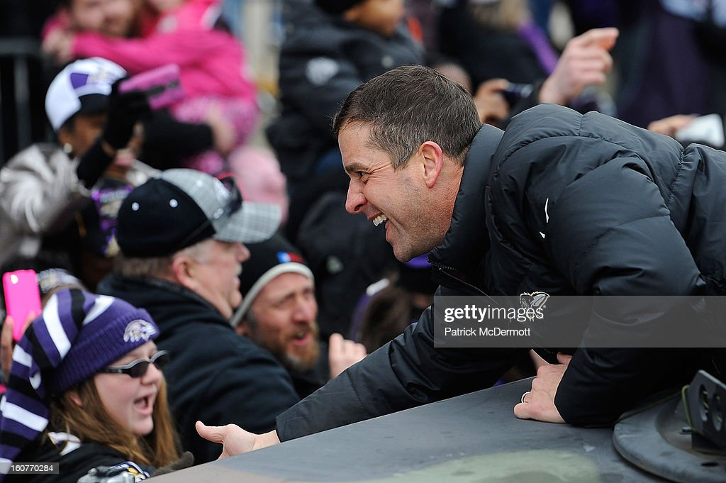 Head coach John Harbaugh of the Baltimore Ravens celebrates with fans during their Super Bowl XLVII victory parade at M&T Bank Stadium on February 5, 2013 in Baltimore, Maryland. The Baltimore Ravens captured their second Super Bowl title by defeating the San Francisco 49ers.