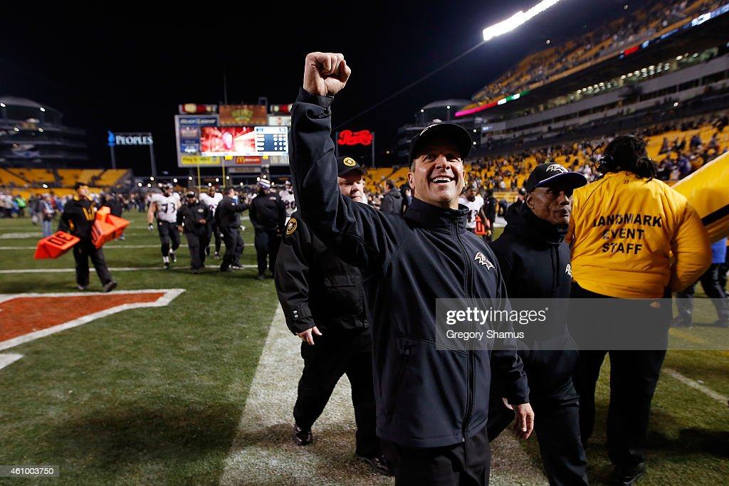 Head coach <a gi-track='captionPersonalityLinkClicked' href=/galleries/search?phrase=John+Harbaugh&family=editorial&specificpeople=763525 ng-click='$event.stopPropagation()'>John Harbaugh</a> of the Baltimore Ravens celebrates with fans after defeating the Pittsburgh Steelers 30-17 in their AFC Wild Card game at Heinz Field on January 3, 2015 in Pittsburgh, Pennsylvania.