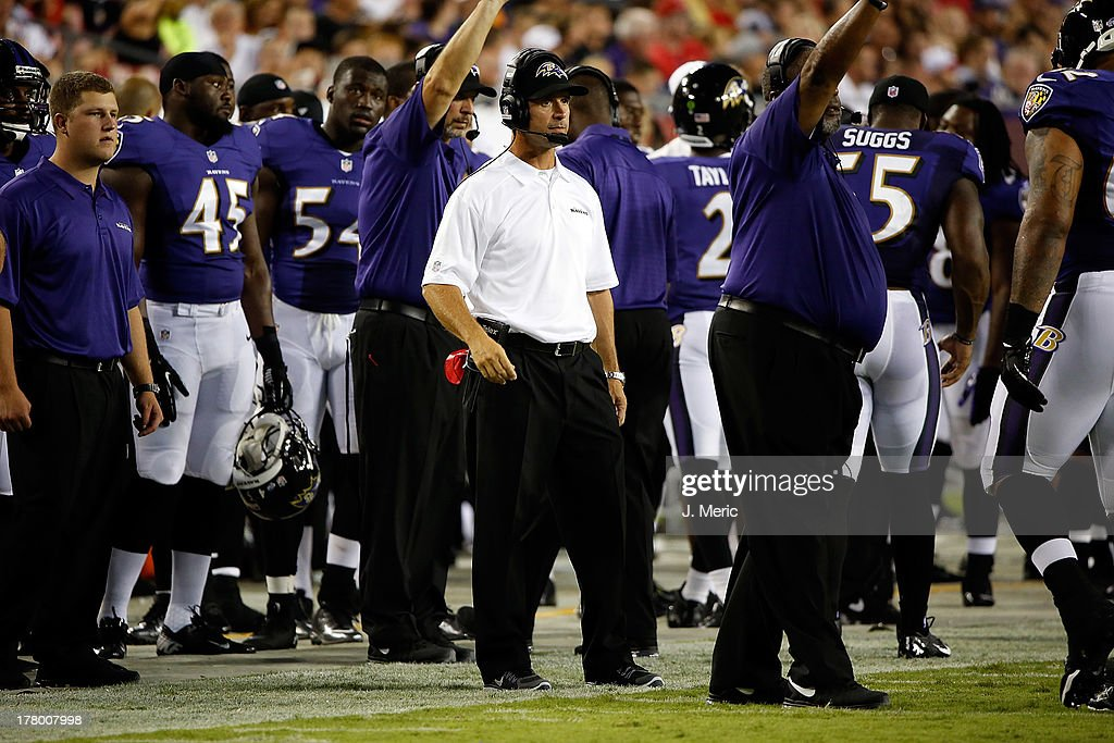 Head coach <a gi-track='captionPersonalityLinkClicked' href=/galleries/search?phrase=John+Harbaugh&family=editorial&specificpeople=763525 ng-click='$event.stopPropagation()'>John Harbaugh</a> of the Baltimore Ravens directs his team against the Tampa Bay Buccaneers during a preseason game at Raymond James Stadium on August 8, 2013 in Tampa, Florida.